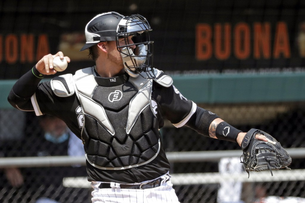 Chicago White Sox catcher Yasmani Grandal throws during baseball practice at Guaranteed Rate Field in Chicago, Thursday, July 9, 2020. (AP Photo/Nam Y...