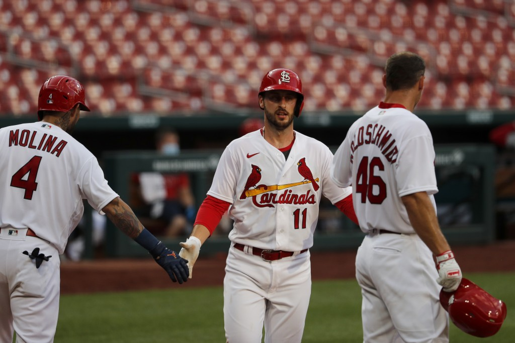 St. Louis Cardinals' Paul DeJong (11) is congratulated by teammates Yadier Molina (4) and Paul Goldschmidt (46) after hitting a two-run home run durin...