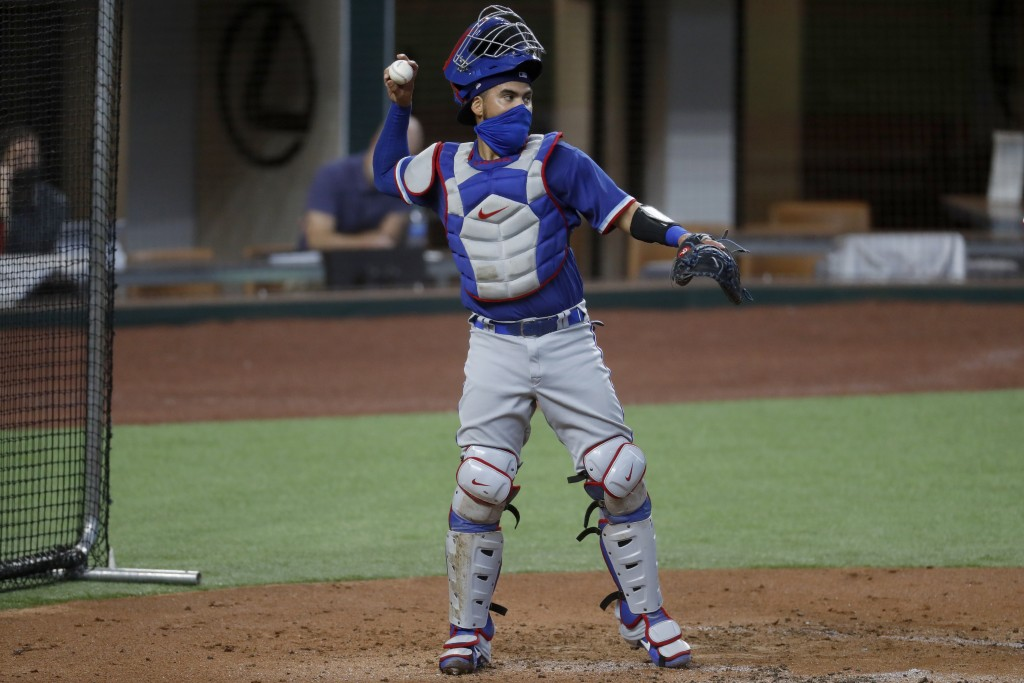 Texas Rangers catcher Robinson Chirinos throws to the mound during an intrasquad game during baseball practice in Arlington, Texas, Thursday, July 9, ...