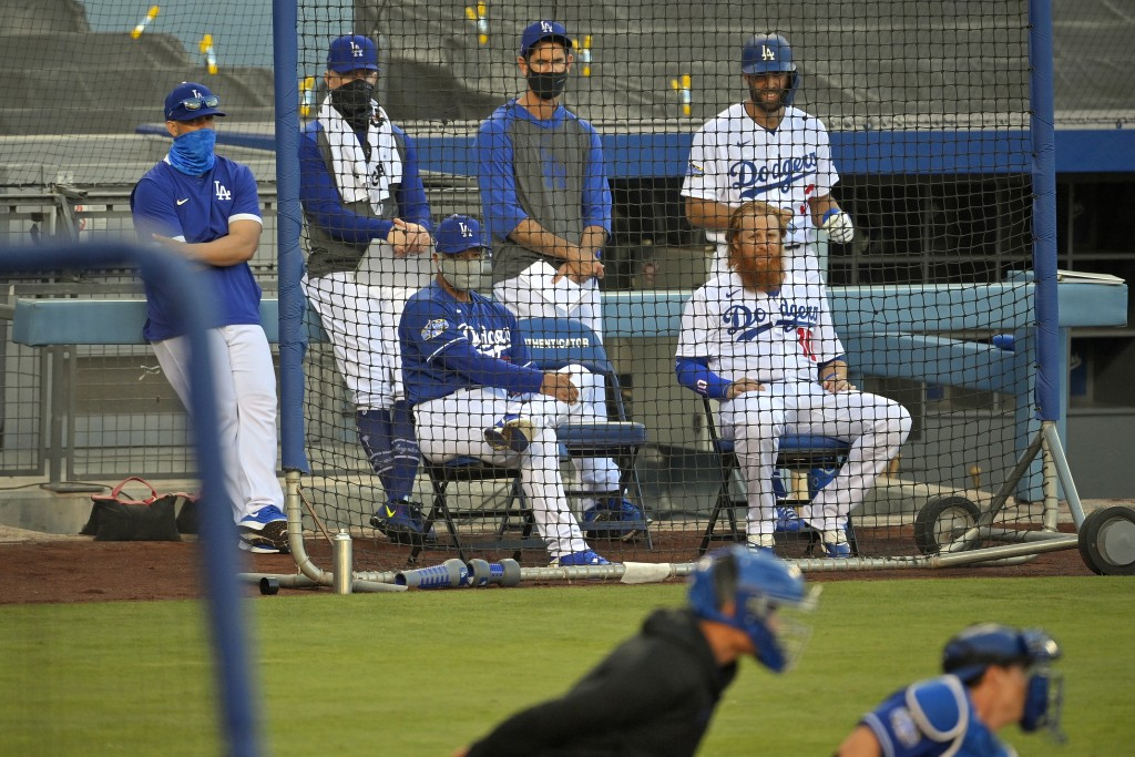 Los Angeles Dodgers manager Dave Roberts, center left, and Justin Turner, center right, watch along with other members of the team during an intrasqua...