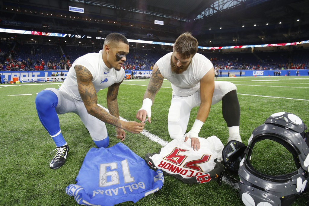 FILE - In this Sunday, Dec. 15, 2019 file photo, Detroit Lions wide receiver Kenny Golladay (19), left, and Tampa Bay Buccaneers linebacker Pat O'Conn...