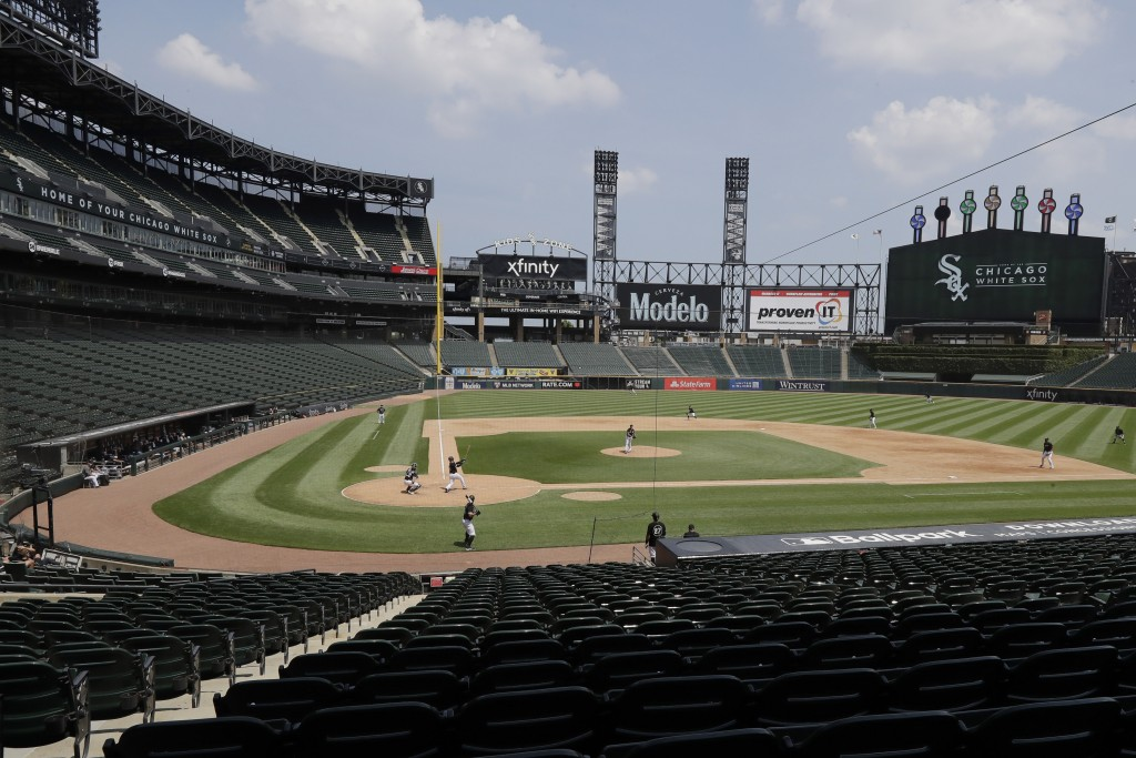 The Chicago White Sox take part in baseball practice at Guaranteed Rate Field in Chicago, Thursday, July 9, 2020. (AP Photo/Nam Y. Huh)