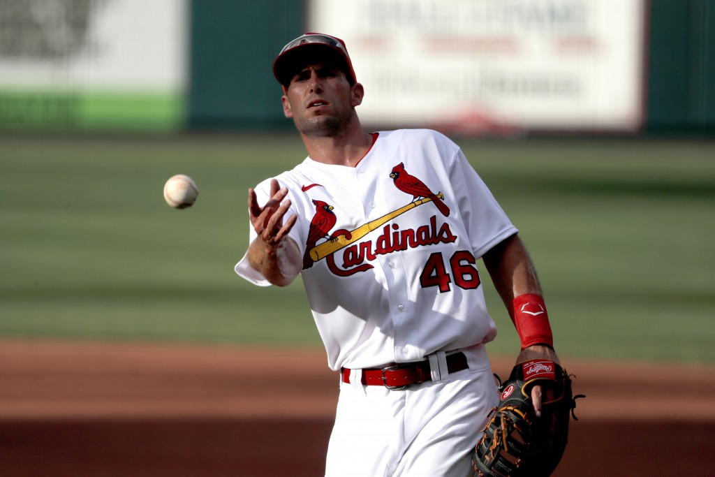 St. Louis Cardinals infielder Paul Goldschmidt tosses a ball toward the dugout during an intrasquad practice baseball game at Busch Stadium Thursday, ...