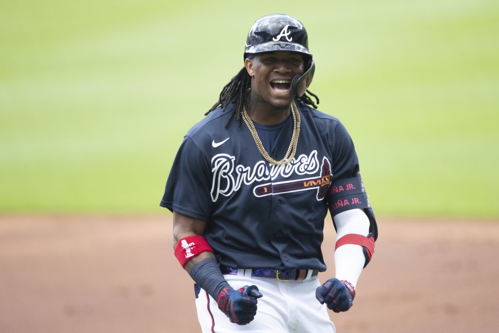 Atlanta Braves center fielder Ronald Acuna Jr. (13) reacts after popping out to second baseman Ozzie Albies during a practice baseball game, Thursday,...