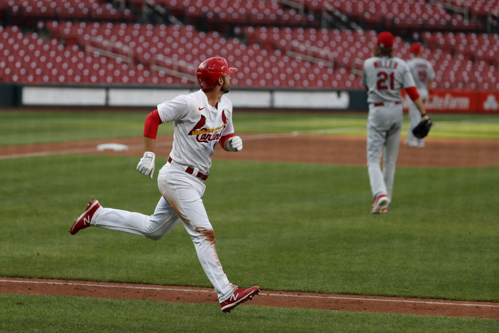St. Louis Cardinals' Paul DeJong, left, rounds the bases after hitting a two-run home run off pitcher Andrew Miller (21) during an intrasquad practice...