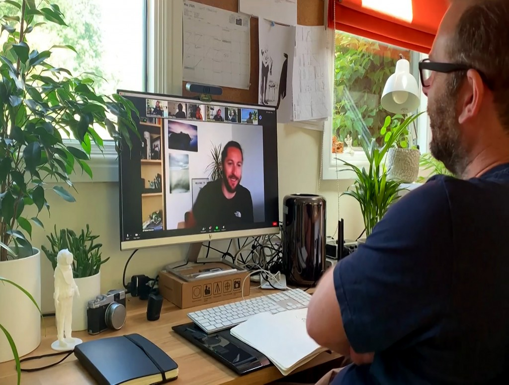 This July 2020 photo taken from video released by Locksmith Animation shows art director Justin Hutchinson-Chatburn, right, communicating on his compu...