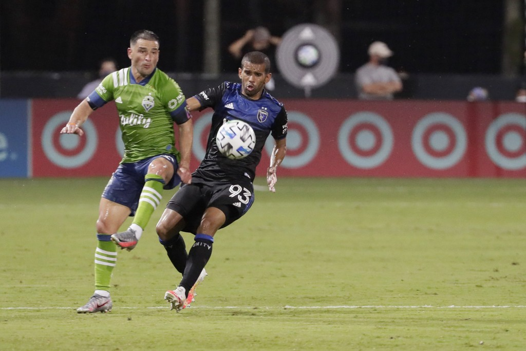 Seattle Sounders midfielder Nicolas Lodeiro, left, and San Jose Earthquakes midfielder Judson battle for position during the second half of an MLS soc...