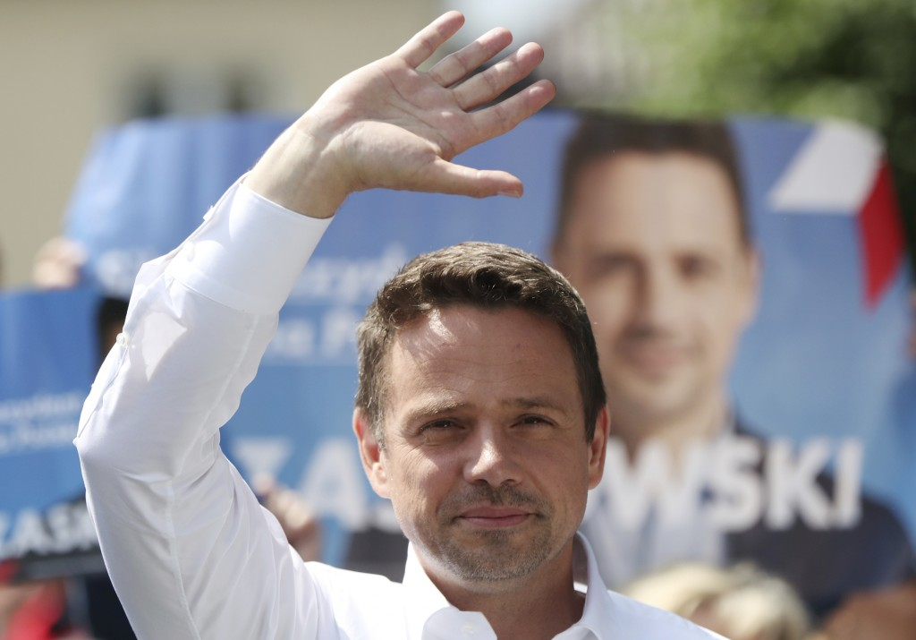 In this Thursday, July 9, 2020 photo Rafal Trzaskowski, contender in Poland's tight presidential election runoff on Sunday, July 12, 2020, waves durin...