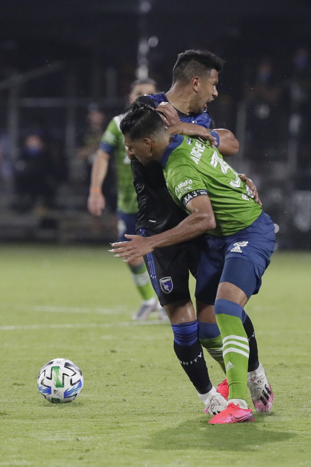 San Jose Earthquakes forward Andres Rios, rear, and Seattle Sounders defender Xavier Arreaga (3) collide as they battle for the ball during the second...