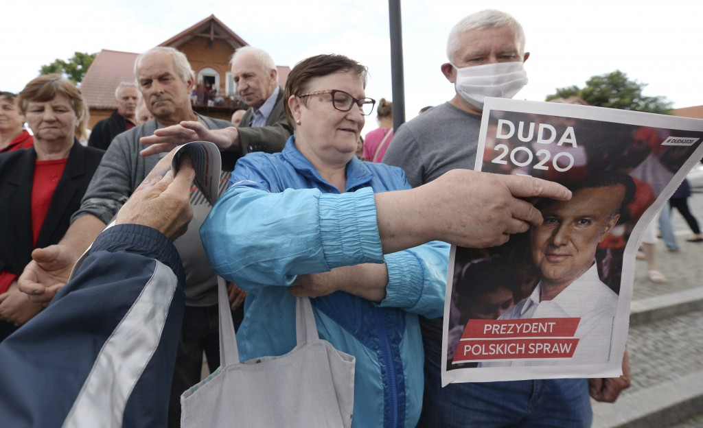 In this Tuesday, July 7, 2020 photo supporters of conservative incumbent president Andrzej Duda, who is seeking reelection in a tight presidential ele...
