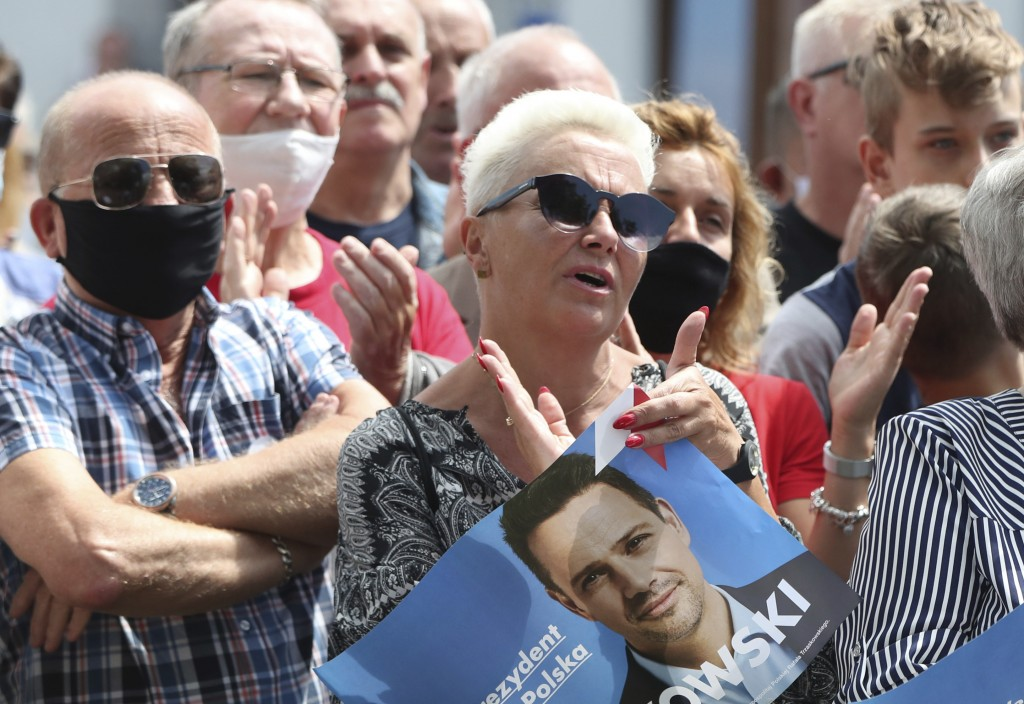 In this Thursday, July 9, 2020 photo people attend a election campaign rally of Rafal Trzaskowski, contender in Poland's tight presidential election r...