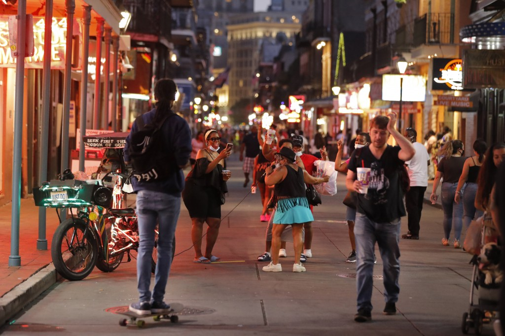 People sing and dance to karaoke on Bourbon Street in New Orleans, Thursday, July 9, 2020. A sharp increase in COVID-19 cases and hospitalizations is ...