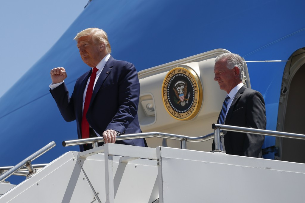 FILE - In this June 11, 2020, file photo President Donald Trump gestures as he steps off Air Force One at Dallas Love Field in Dallas with Senate cand...