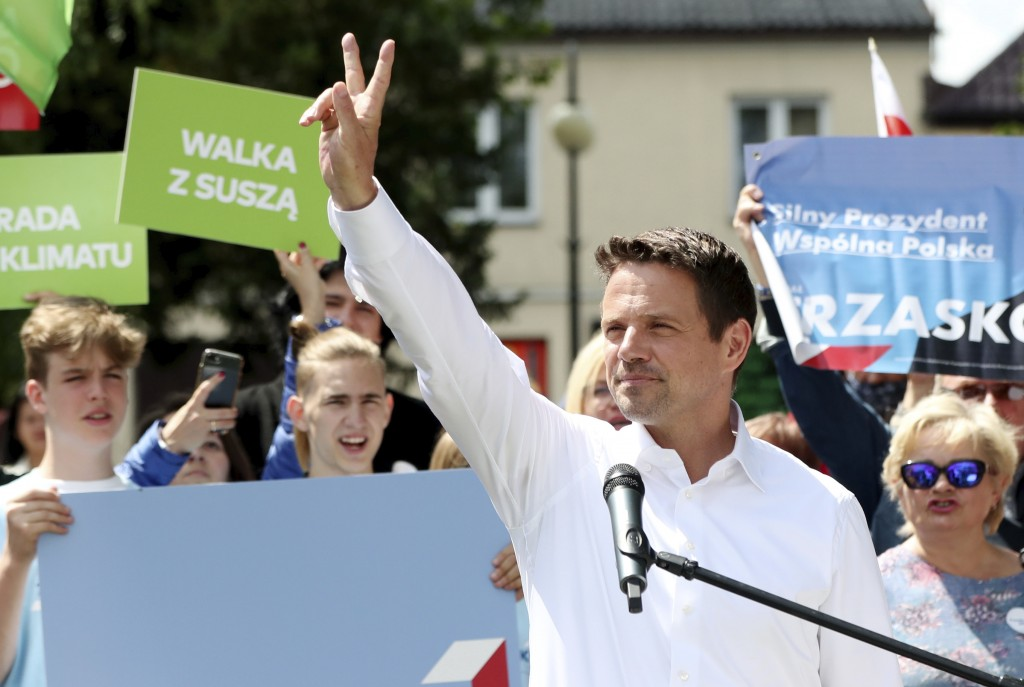 In this Thursday, July 9, 2020 photo Rafal Trzaskowski, contender in Poland's tight presidential election runoff on Sunday, July 12, 2020, gestures du...