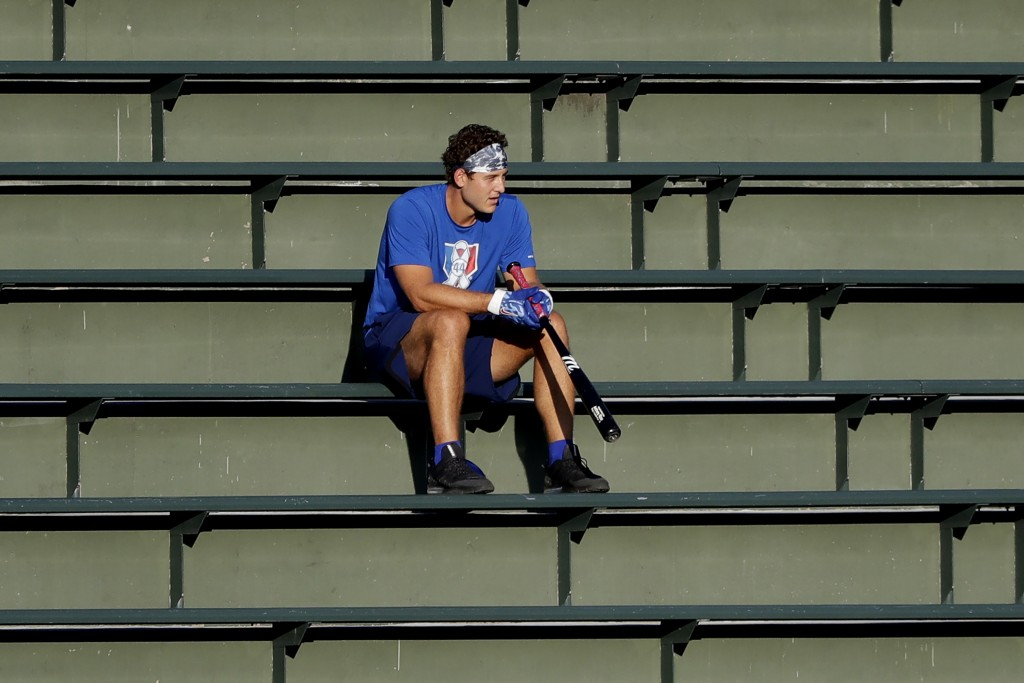 Chicago Cubs infielder Anthony Rizzo watches teammates during baseball practice at Wrigley Field in Chicago, Friday, July 10, 2020. (AP Photo/Nam Y. H...