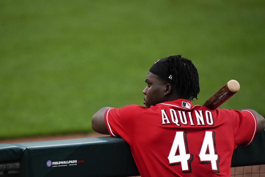 Cincinnati Reds right fielder Aristides Aquino (44) watches team baseball practice from the dugout at Great American Ballpark in Cincinnati, Friday, J...
