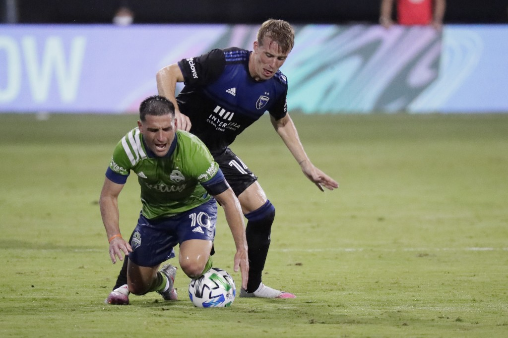 Seattle Sounders midfielder Nicolas Lodeiro (10) goes down as he battle for the ball against San Jose Earthquakes midfielder Jackson Yueill during the...