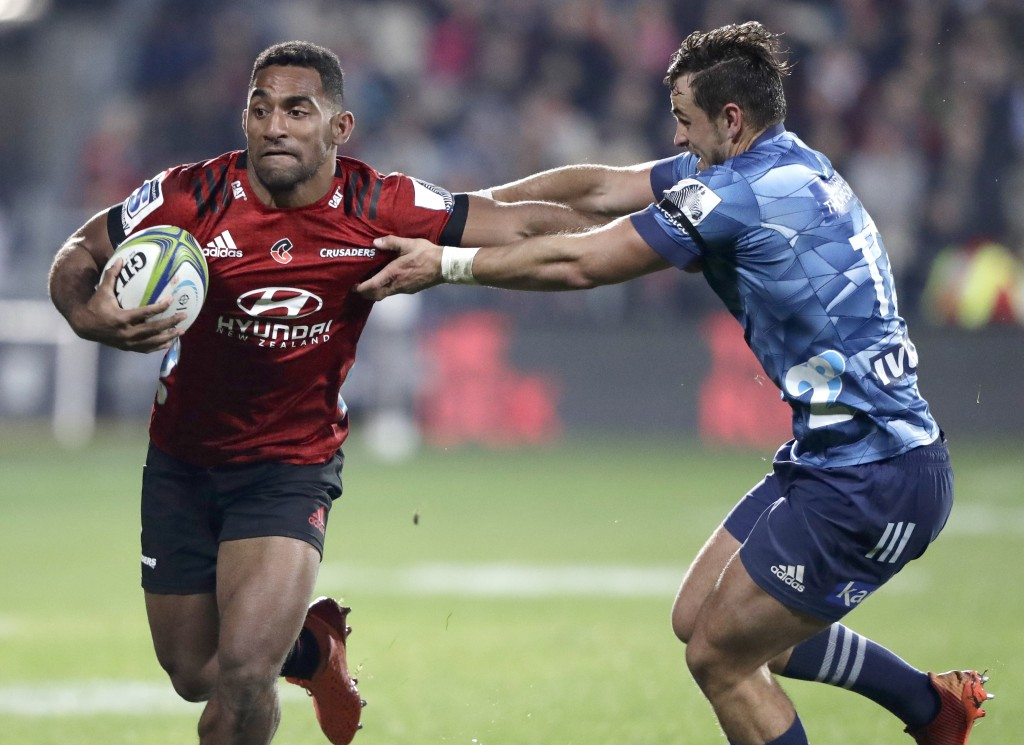 Crusaders Sevu Reece, left, runs at Blues Harry Plummer during the Super Rugby Aotearoa rugby game between the Crusaders and the Blues in Christchurch...