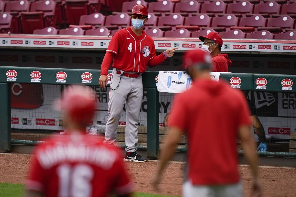 Cincinnati Reds center fielder Shogo Akiyama (4) speaks with a member of the staff during team baseball practice at Great American Ballpark in Cincinn...