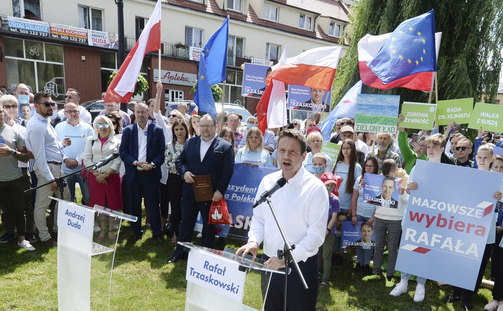 In this Thursday, July 9, 2020 photo Rafal Trzaskowski, front, contender in Poland's tight presidential election runoff on Sunday, July 12, 2020, spea...