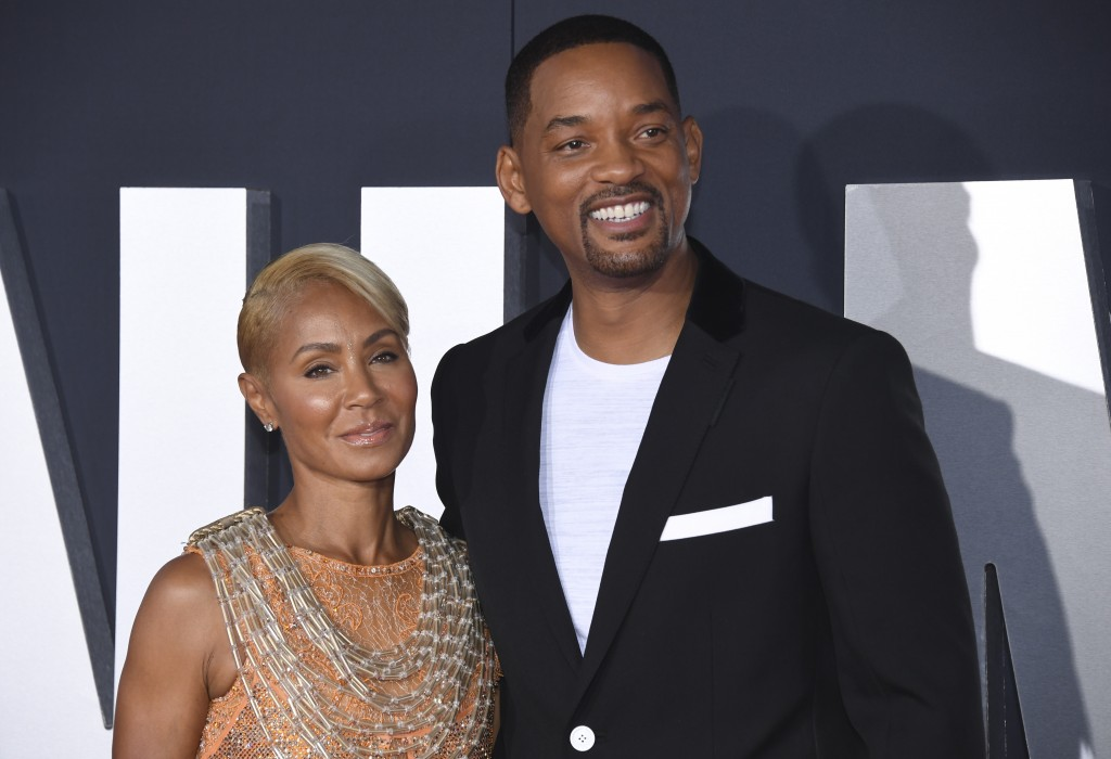 """FILE - In this Oct. 6, 2019 file photo, Jada Pinkett Smith, left, and her husband Will Smith attend the premiere of """"Gemini Man"""" in Los Angeles. Pinke..."""