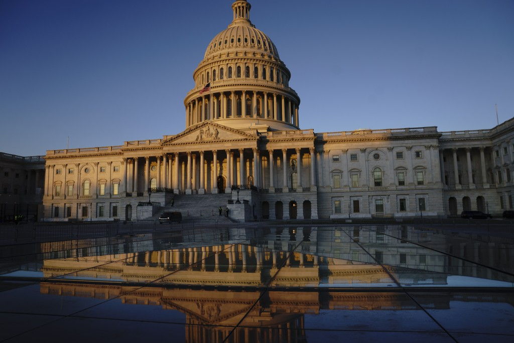 FILE - In this Jan. 21, 2020, file photo, the U.S. Capitol is seen at sunrise in Washington. President Donald Trump isn't just changing the presidency...