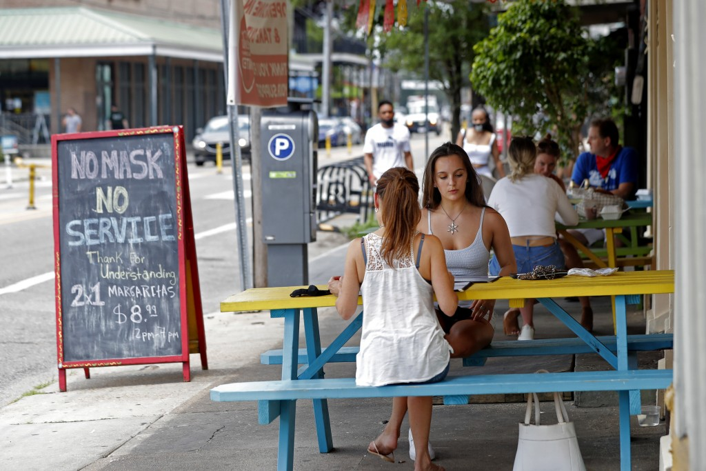 Maria Jones, center right, sits at an outdoor table with her mother Stacey Jones at El Paso Mexican Grill on Magazine Street in New Orleans, Thursday,...