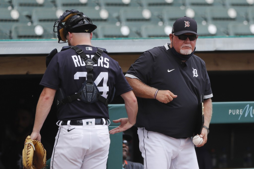 Detroit Tigers manager Ron Gardenhire elbow bumps catcher Jake Rogers after an intrasquad baseball game, Friday, July 10, 2020, in Detroit. (AP Photo/...