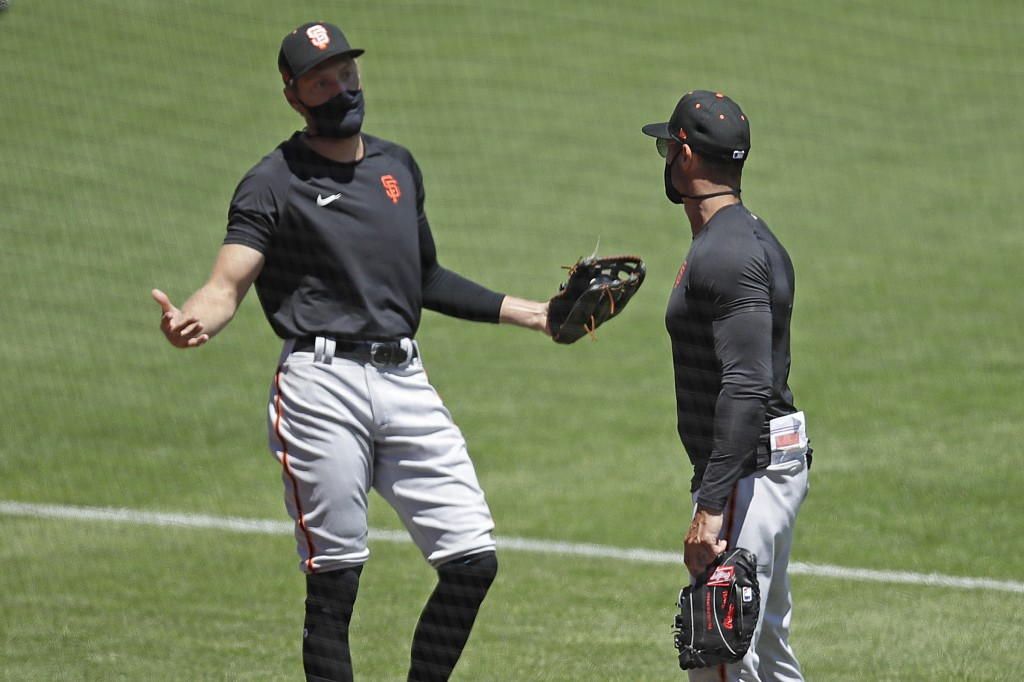 San Francisco Giants' Hunter Pence, left, gestures while speaking with manager Gabe Kapler during a baseball practice Friday, July 10, 2020, in San Fr...