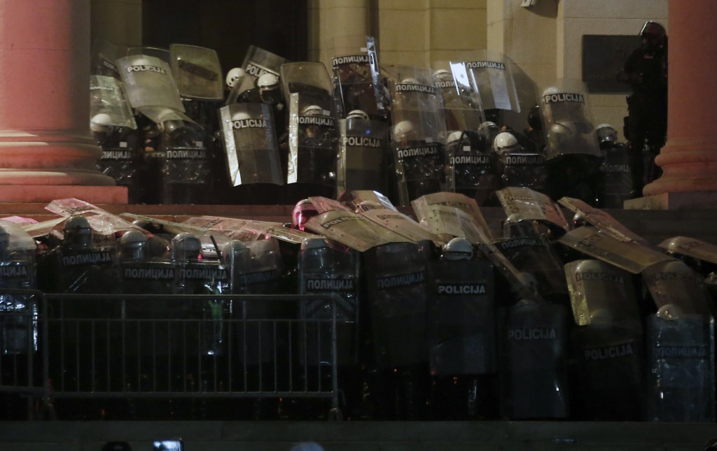 Serbian riot police guard the Serbian parliament building during a protest in Belgrade, Serbia, Friday, July 10 2020. Hundreds of demonstrators tried ...