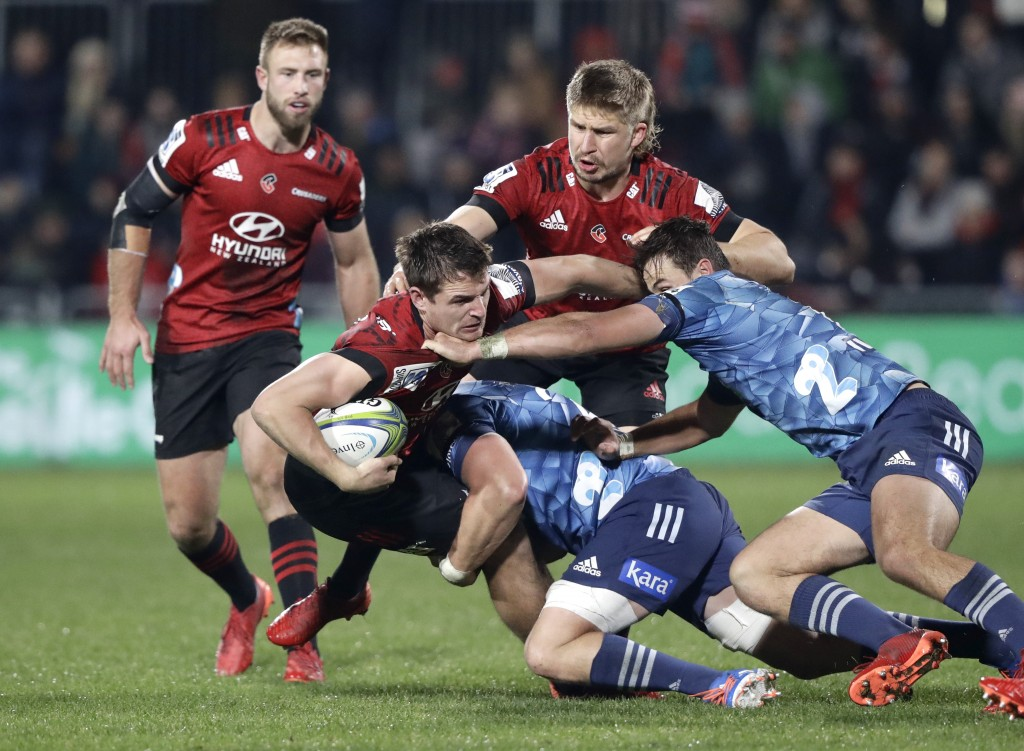 Crusaders George Bridge is tackle day the Blues defence during the Super Rugby Aotearoa rugby game between the Crusaders and the Blues in Christchurch...