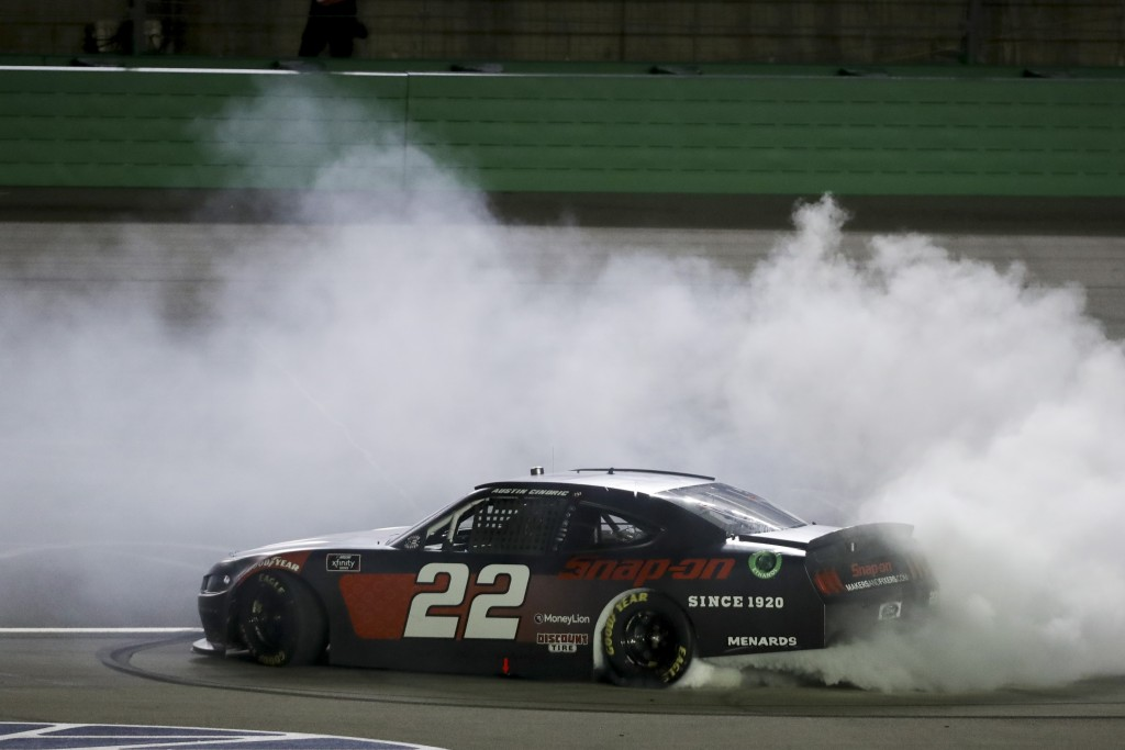 Austin Cindric (22) celebrates after winning a NASCAR Xfinity Series auto race Friday, July 10, 2020, in Sparta, Ky. (AP Photo/Mark Humphrey)