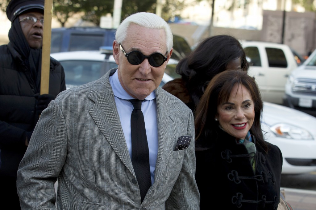 FILE - In this Nov. 14, 2019, file photo, Roger Stone accompanied by his wife Nydia Stone, right, arrives at federal court in Washington. (AP Photo/Jo...