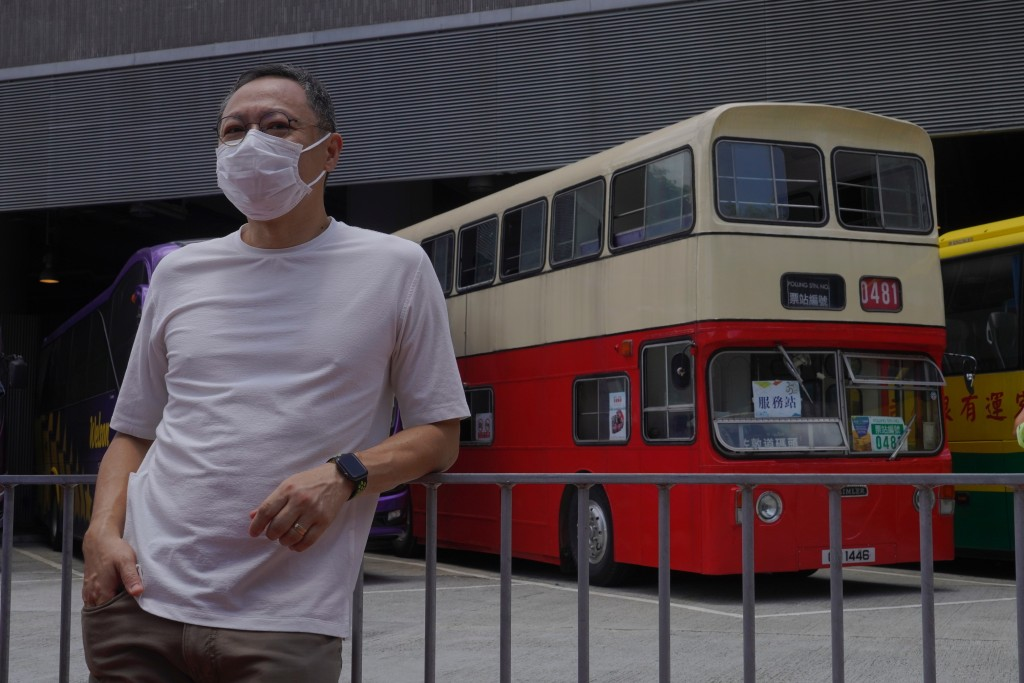 Occupy Central leader Benny Tai stands in front of a vintage double-deck bus used as a polling center for voting in Hong Kong Saturday, July 11, 2020,...