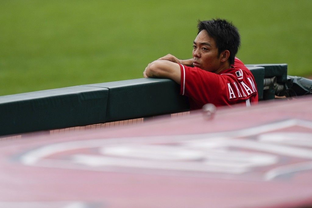 Cincinnati Reds center fielder Shogo Akiyama watches team baseball practice from the dugout at Great American Ballpark in Cincinnati, Friday, July 10,...