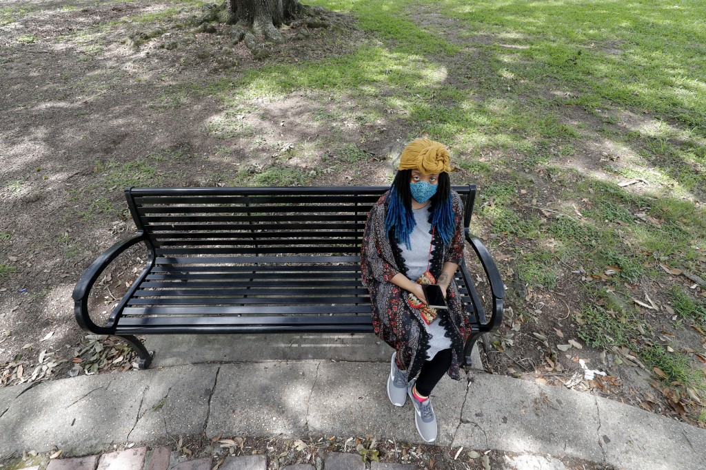 Jasmin Pierre poses for a photo with her smartphone app, in New Orleans, Thursday, July 2, 2020. Pierre, who survived multiple suicide attempts, doesn...