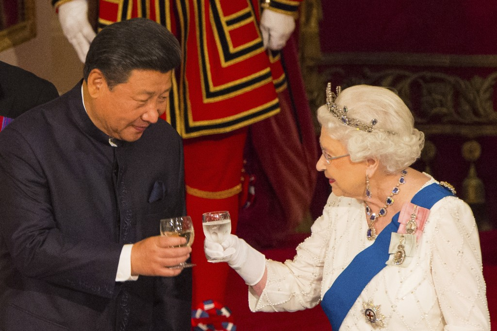 FILE - In this Tuesday Oct. 20, 2015 file photo, Chinese President Xi Jinping with Britain's Queen Elizabeth II during a state banquet at Buckingham P...