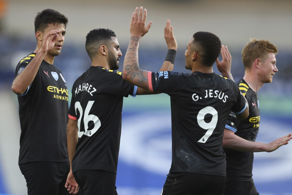 Manchester City's Gabriel Jesus (9) celebrates after scoring his side's second goal during the English Premier League soccer match between Brighton an...