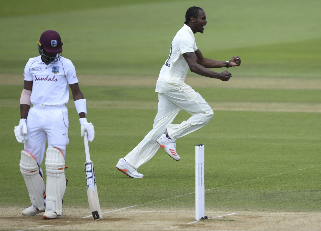 England's Jofra Archer, right, celebrates the dismissal of West Indies' Shamarh Brooks, left, during the fifth day of the first cricket Test match bet...