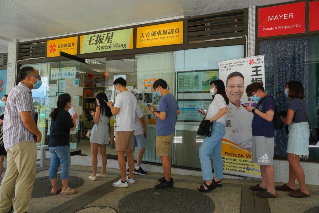 People queue up to vote in Hong Kong Sunday, July 12, 2020, in an unofficial primary for pro-democracy candidates ahead of legislative elections in Se...