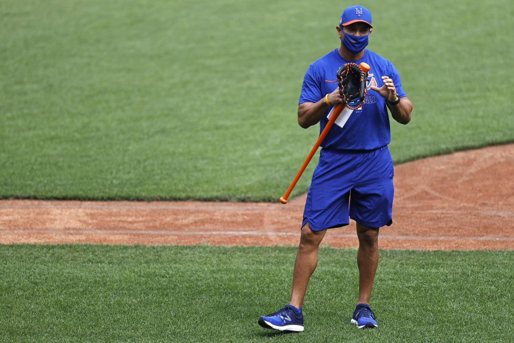 FILE - In this Friday, July 3, 2020, file photo, New York Mets manager Luis Rojas speaks during a baseball workout at Citi Field in New York. Rojas an...