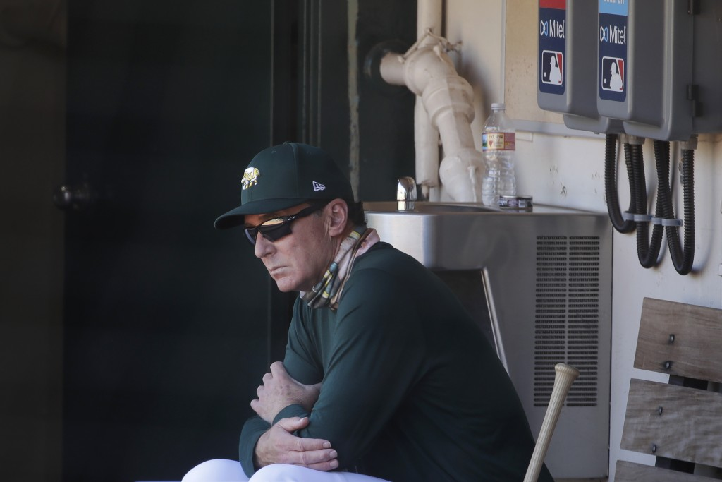 Oakland Athletics manager Bob Melvin watches from the dugout during a baseball practice in Oakland, Calif., Saturday, July 11, 2020. (AP Photo/Jeff Ch...
