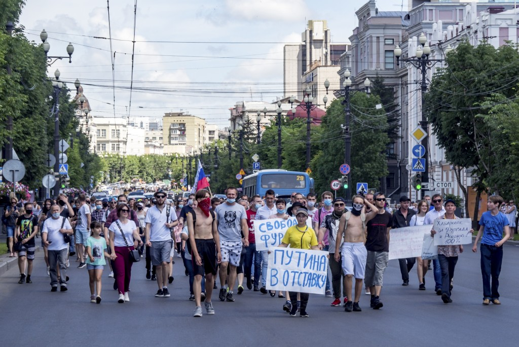"""People hold posters that read: """"Freedom for Sergei Furgal"""" and """"Putin to Resign!"""", during an unsanctioned protest in support of Sergei Furgal, the gov..."""