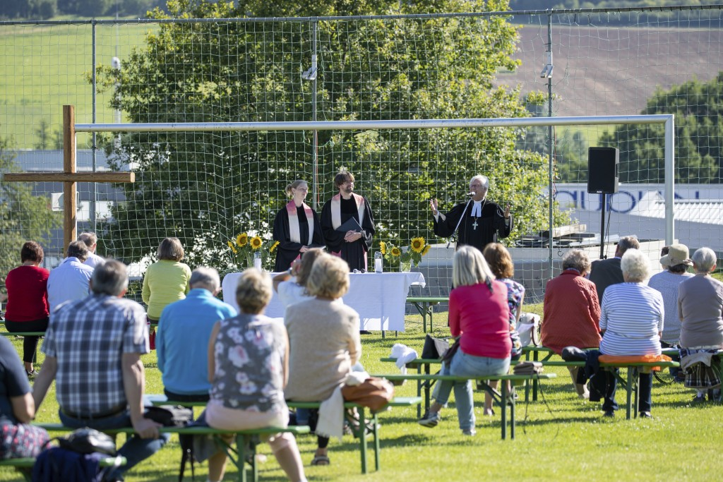 Lutheran Bishop of Bavaria Heinrich Bedford-Strohm, right in the goal, hold a church service on a football field in Offenhause, Germany, Sunday, July ...