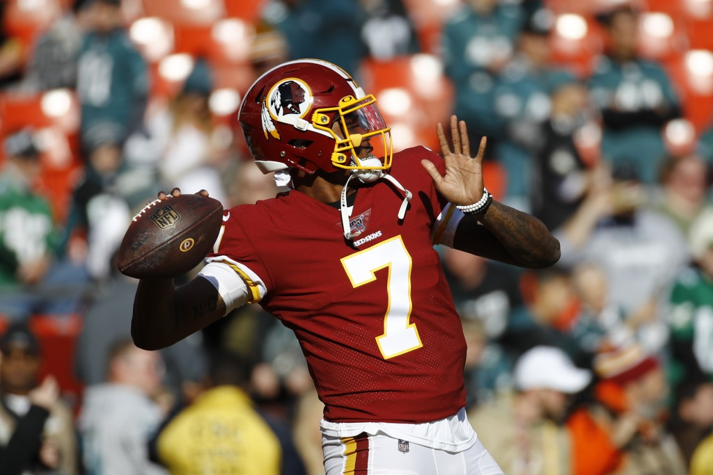 FILE - In this Dec. 15, 2019, file photo, Washington Redskins quarterback Dwayne Haskins warms up before an NFL football game in Landover, Md. A new n...