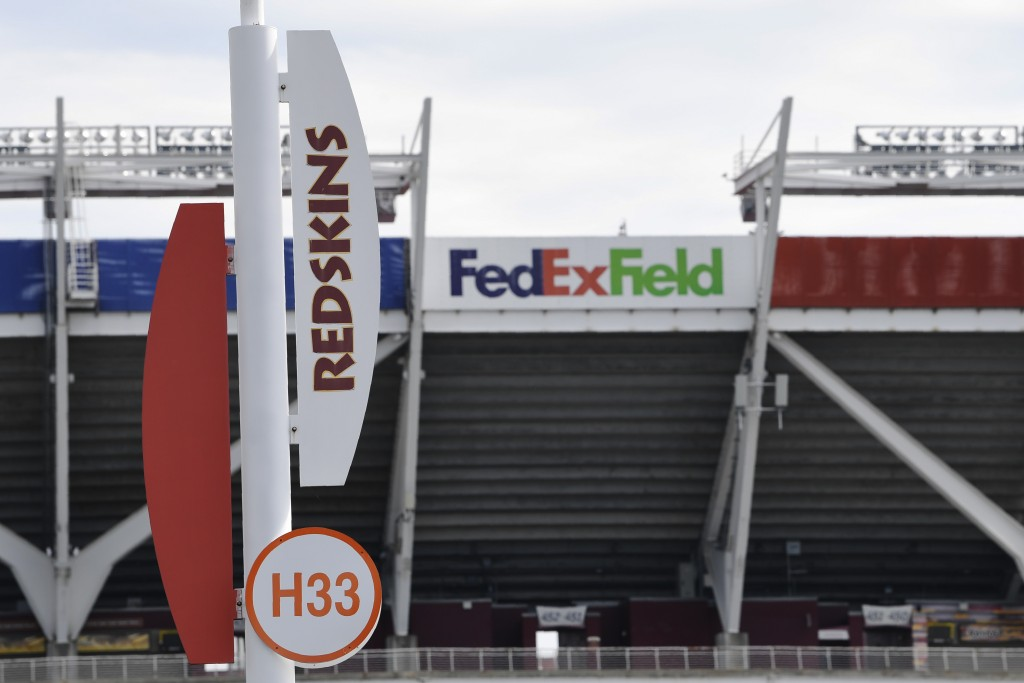 Signs for the Washington Redskins are displayed outside FedEx Field in Landover, Md., Monday, July 13, 2020. The Washington NFL franchise announced Mo...