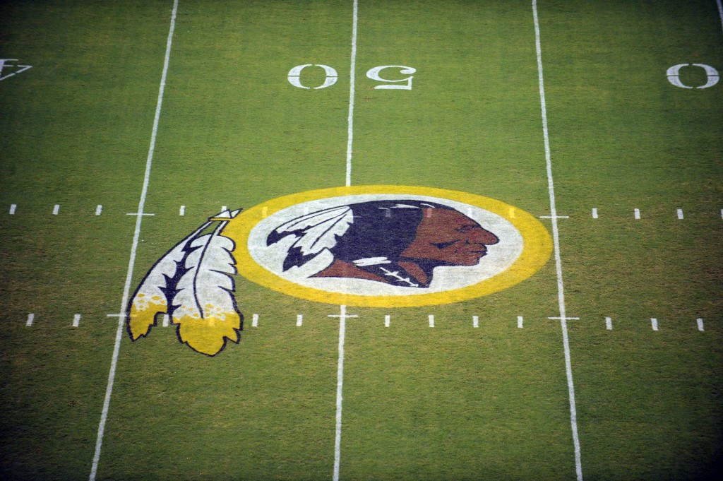 FILE - In this Aug. 28, 2009 file photo, the Washington Redskins logo is shown on the field before the start of a preseason NFL football game against ...