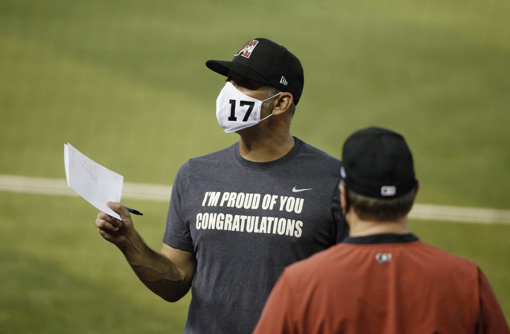 Arizona Diamondbacks manager Torey Lovullo, left, talks with other coaches during a baseball training camp intrasquad scrimmage Sunday, July 12, 2020,...