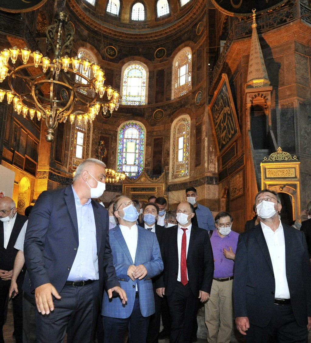 Turkish Culture and Tourism Minister Mehmet Nuri Ersoy, left, and other officials visit the Byzantine-era Hagia Sophia, one of Istanbul's main tourist...