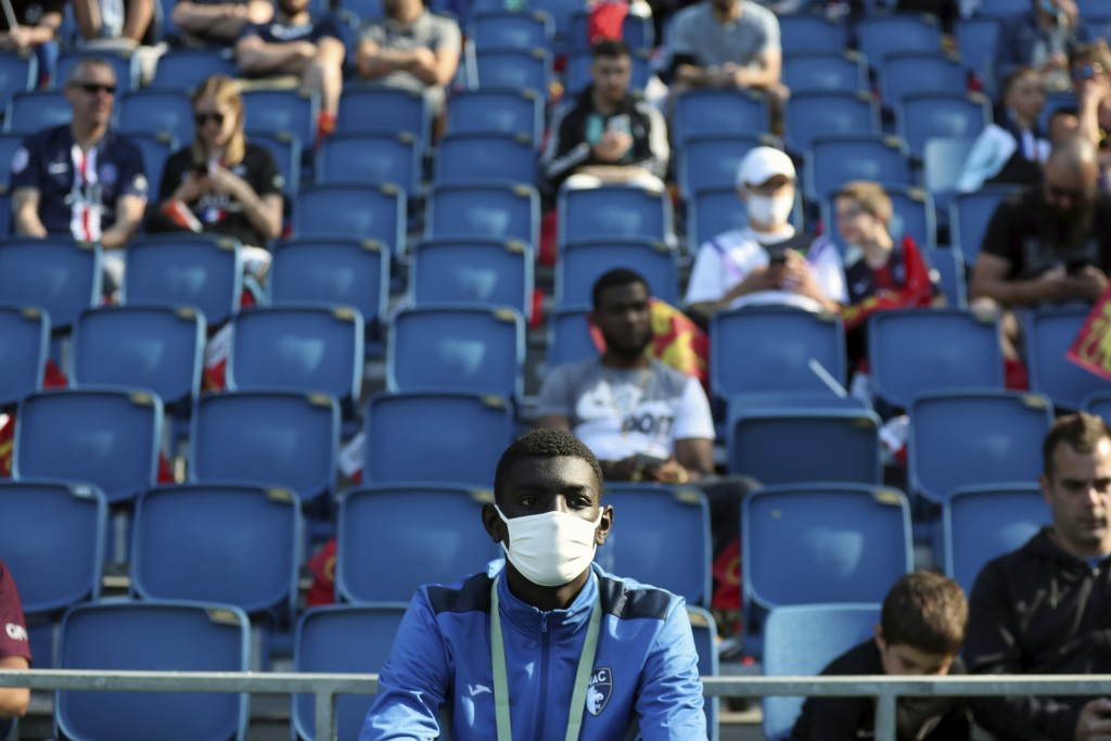A ball carrier wears a face mask prior to the friendly soccer match between Paris Saint Germain and Le Havre, in Le Havre, western France, Sunday, Jul...